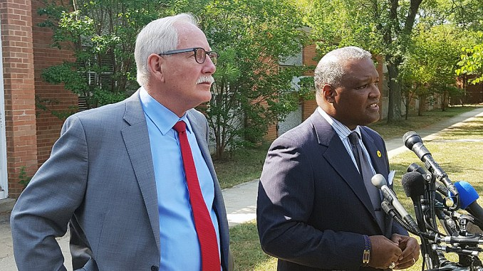 Prince George's County Executive Rushern L. Baker III (right) and public schools CEO Kevin Maxwell speak to reporters outside Glassmanor Elementary in Oxon Hill on Aug. 29, the first day of school for the county's Head Start program.