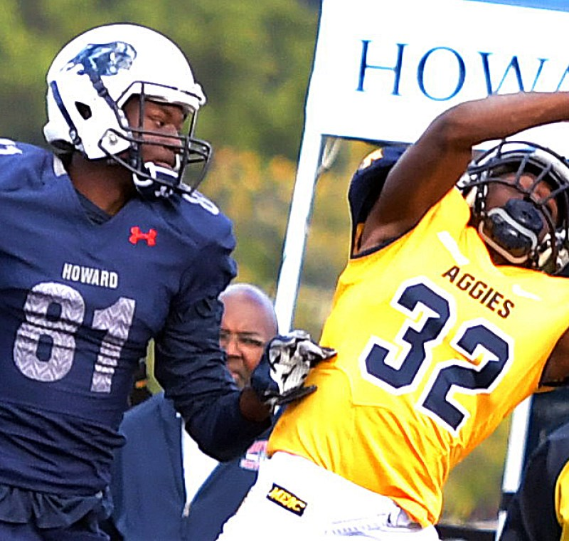 North Carolina A&T cornerback Marquis Willis misses an interception opportunity while defending Howard Bison wide receiver Kyle Anthony during the Aggies' 34-7 win in what was Howard's homecoming game on Saturday, Oct. 22 at William H. Greene Stadium in northwest D.C. /Photo by John E. De Freitas
