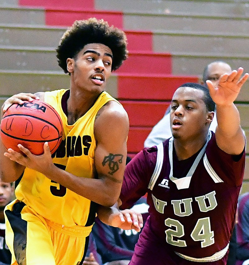 University of the District of Columbia guard Traevon Butler is defended by Virginia Union guard Eric Cheatham in the first half of Virginia Union's 71-69 win at UDC Gymnasium in Northwest on Wednesday, Nov. 30. /Photo by John E. De Freitas