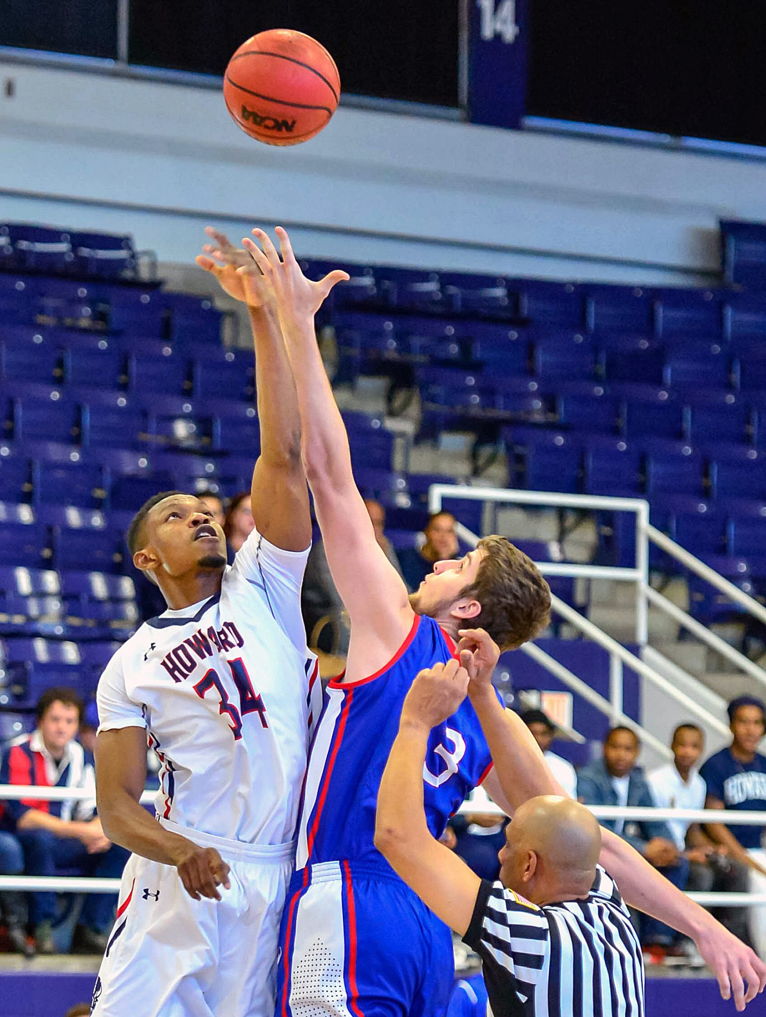 Howard University forward Michael Obindu wins the opening tipoff of Howard's 71-54 win over the American University Eagles at Burr Gymnasium in Northwest on Saturday, Dec. 3./Photo courtesy Abdullah Yusuf