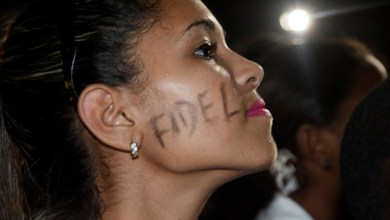 Havana, Cuba - November 29, 2016: A beautiful young Cuban girl has the name of Fidel painted across her cheek at the memorial services held for the former Cuban leader in Havana, Cuba. /Photo: iStock