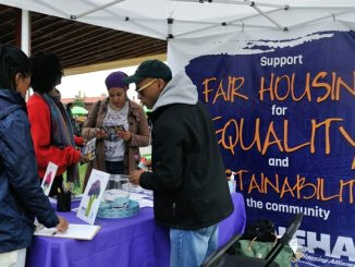 Festival attendees receive literature from the National Fair Housing Alliance during the third annual Broccoli City Festival at the DC gateway pavilion on Saturday, April 30, 2016 in Southeast. /Photo by Patricia Little
