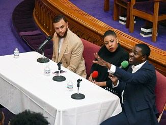 "From left: Singer Jidenna, CNN political commentator Symone Sanders and Stephen Green, president of the NAACP's Youth and College Division, attend the ""People's Inauguration"" rally at Metropolitan AME Church in Northwest on Saturday, Jan. 21. (Travis Riddick/The Washington Informer)"