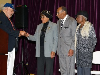 From left: Armstrong Technical School alumnus Jesse Davis (Class of '45) gives special recognition to alumni treasurer Dorothy Brown ('49), alumni President James Nero ('51) and alumni Officer Doris McCannon ('52). /Photo by Lateef Mangum