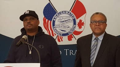 Trap Thomas (left), a former Metro track inspector, speaks during a Jan. 4 news conference at the AFL-CIO headquarters in northwest D.C. after being fired earlier in the day, which he said was retaliation for a whistleblower case. (William J. Ford/The Washington Informer)