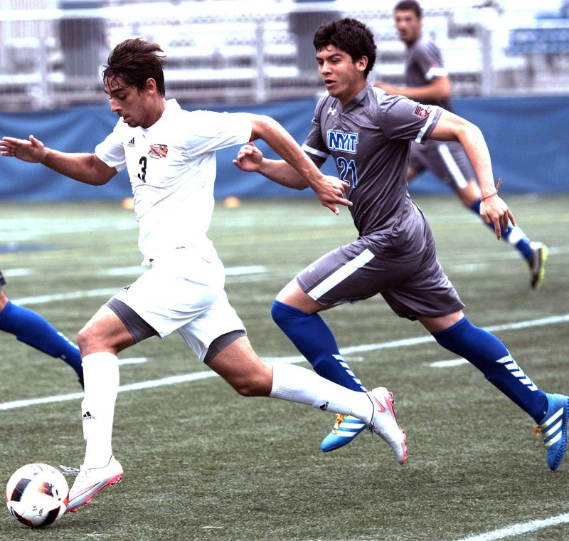 University of the District of Columbia midfielder Gabriel Torres outruns New York Institute of Technology midfielder Alejandro Porras at Georgetown University's Cooper Field in northwest D.C. on Saturday, Oct. 1. NYIT defeated UDC 3-0. /Photo by John E. De Freitas