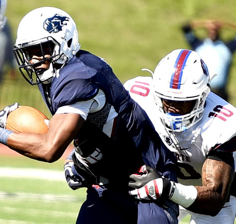 Howard running back Anthony Philyaw is tackled by South Carolina State linebacker Darius Leonard during South Carolina State's 14-9 win at William H. Greene Stadium in northwest D.C. on Saturday, Oct. 15. /Photo by John E. De Freitas