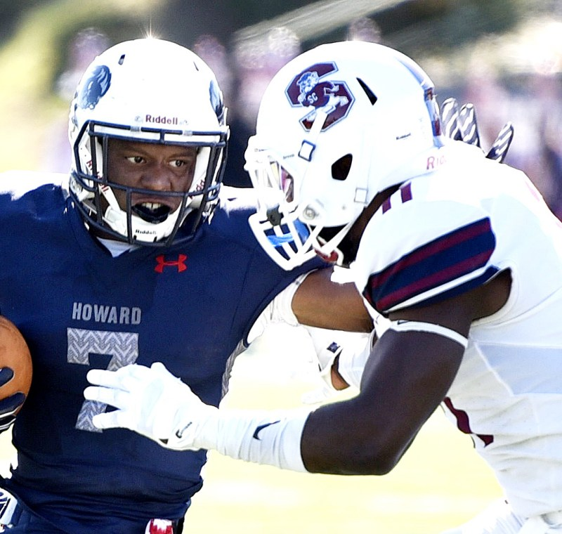 Howard running back Anthony Philyaw protects the football from South Carolina State linebacker Tyler Smith during South Carolina State's 14-9 win at William H. Greene Stadium in northwest D.C. on Saturday, Oct. 15. /Photo by John E. De Freitas
