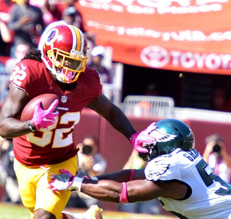 Washington Redskins running back Robert Kelley sloughs off Philadelphia Eagles defensive end Brandon Graham during the Redskins' 27-20 win at FedEx Field in Landover, Maryland, on Sunday, Oct. 16. /Photo by John E. De Freitas