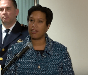 D.C. Mayor Muriel Bowser speaks at the Wilson Building in Northwest to announce her signing of legislation that makes it a criminal offense for persons on probation or parole to tamper with GPS monitoring devices.