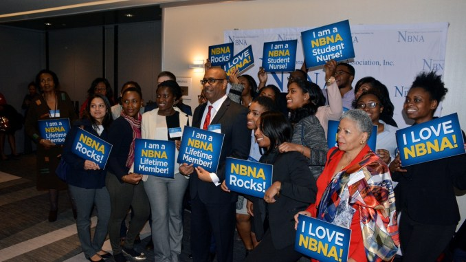 Eric Williams, president of the National Black Nurses Association, stands with lifetime members of the organization during the 29th annual NBNA Day on Capitol Hill on Feb. 2. (Roy Lewis/The Washington Informer)