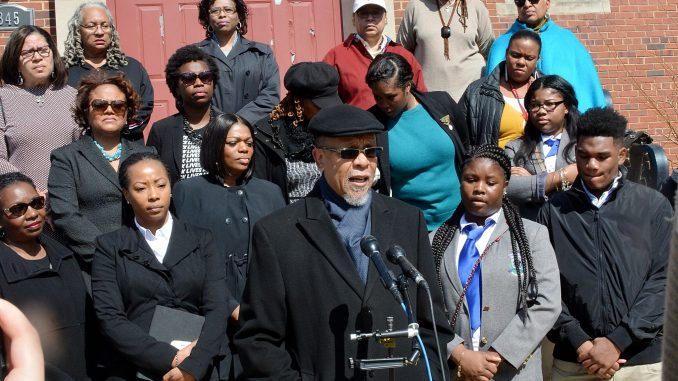 Dennis W. Wiley, pastor of the Covenant Baptist United Church of Christ in Southwest, joins other ministers calling for increased attention to the high number of children missing in the District on March 20. (Roy Lewis/The Washington Informer)