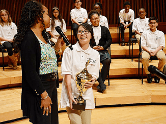 Washington Informer publisher Denise Rolark Barnes congratulates the Prince George's County 2017 Spelling Bee champion Kelly Han, a student at Buck Lodge Middle School. The spelling bee was held at the Clarice Smith Performing Arts Center on March 17. (Roy Lewis/The Washington Informer)