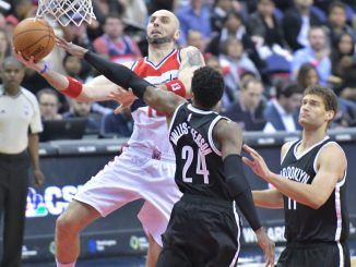 Washington Wizards center Marcin Gortat attempts a layup beyond the outstretched arm of Brooklyn Nets forward Rondae Hollis-Jefferson in the third quarter of the Wizards' 129-108 win at Verizon Center in northwest D.C. on March 24. (John De Freitas/The Washington Informer)