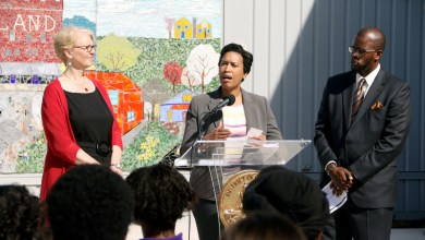 D.C. Mayor Muriel Bowser (center), with Deputy Mayor of Education Jennifer Niles (left) and DCPS Chancellor Antwan Wilson (right), announces plans to invest $6.2 million in the city's public middle and high schools during a press conference at Brookland Middle School in Northeast on Feb. 24. (Shevry Lassiter/The Washington Informer)