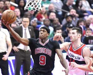 Chicago Bulls point guard Rajon Rondo attempts a layup ahead of Washington Wizards forward Jason Smith during the Wizards' 112-107 win at Verizon Center in D.C. on March 17. (John De Freitas/The Washington Informer)