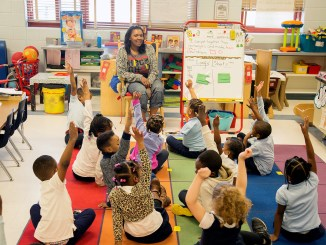Dana Patterson teaches young students in her pre-kindergarten classroom at Cora Elementary School in Landover, Maryland, on March 20. (Mark Mahoney)