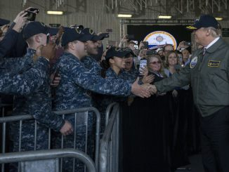 President Trump greets sailors after entering the hangar bay aboard the USS Gerald R. Ford in Newport News, Virginia, on March 2. (Mass Communication Specialist 3rd Class Cathrine Mae O. Campbell/U.S. Navy)