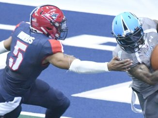 Philadelphia Soul wide receiver Chris Duvalt evades Washington Valor Bernard Morris during Philadelphia's 49-31 win at Verizon Center in Northwest on April 22. (John E. De Freitas/The Washington Informer)
