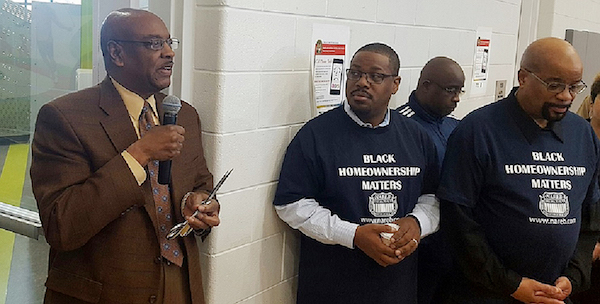 Prince George's County Councilman Obie Patterson (left) speaks during an April 8 homeownership event in Fort Washington sponsored by the National Association of Real Estate Brokers. (William J. Ford/The Washington Informer)