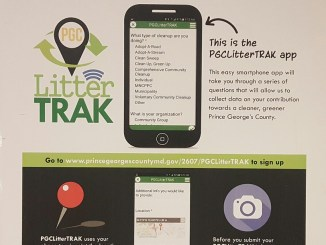 "A flier showcases information on the ""PGCLitterTRAK"" smartphone app. Nearly two dozen people heard a presentation March 30 in Largo on how to log on and use the app. (William J. Ford/The Washington Informer)"