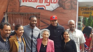 Washington Wizards guards John Wall and Bradley Beal pose with the Ali family, owners of Ben's Chili Bowl, outside the northwest D.C. eatery on April 13. A mural depicting the two stars now adorns a wall outside the local landmark. (William J. Ford/The Washington Informer)
