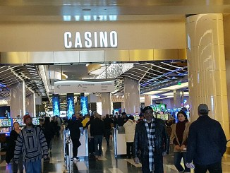 Patrons head in and out of the MGM National Harbor casino resort on Dec. 11, three days after it opened for business. (William J. Ford/The Washington Informer)