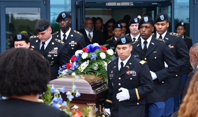 Members of the Bowie State University ROTC carry the casket of Richard Collins III, a Bowie State student fatally stabbed in a possible hate crime, during a May 26 funeral service at First Baptist Church of Glenarden in Upper Marlboro, Maryland. (Travis Riddick/The Washington Informer)
