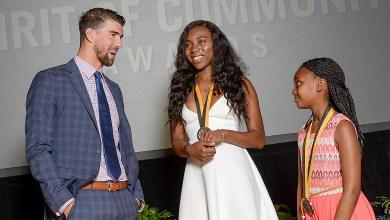 Ayomide Okuleye, 17, and Debora Abera, 11, are honored for their volunteer service during the 22nd annual Prudential Spirit of Community Awards at the National Museum of Natural History in D.C. on May 7, as Olympic gold medalist Michael Phelps presents the awards. (Courtesy of Prudential Financial)
