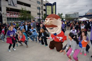 Washington Nationals mascot Teddy warms up with participants for the annual March for Babies at Nationals Park on May 6. (Roy Lewis/The Washington Informer)