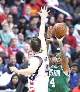 Boston Celtics point guard Isaiah Thomas attempts a jump shot over Washington Wizards forward Jason Smith in the first quarter of the Wizards' 92-91 victory in Game 6 of the Eastern Conference semifinals at Verizon Center in D.C. on May 13. (John De Freitas/The Washington Informer)