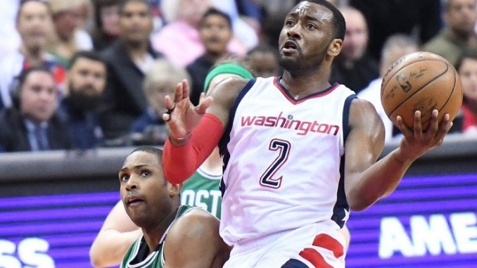 Washington Wizards point guard John Wall (2) drives pass Boston Celtics center Al Horford in the third quarter of the Wizards' 121-102 win in Game 4 of the Eastern Conference semifinals series at Verizon Center at D.C. on May 7. (John De Freitas/The Washington Informer)