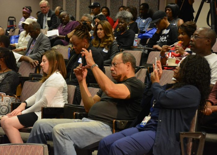"""Audience members listen to a panel discussion during the Sibley Oncology Clinic at United Medical Center's """"Cancer Awareness Day"""" in southeast D.C. on May 20, 2017. (Roy Lewis/The Washington Informer)"""