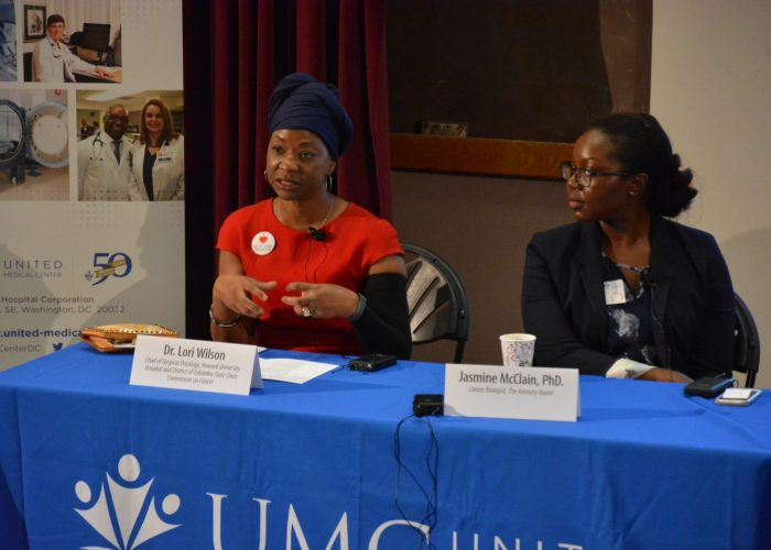 """Dr. Lori Wilson (left), chief surgical oncologist at Howard University, gives details on why some cancers spread in the black community during the Sibley Oncology Clinic at United Medical Center's """"Cancer Awareness Day"""" in southeast D.C. on May 20, 2017. (Roy Lewis/The Washington Informer)"""