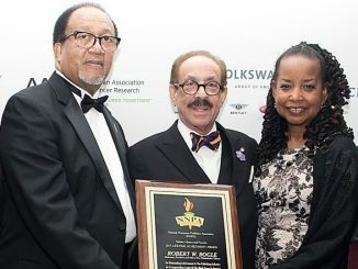 From left: Benjamin Chavis, NNPA president and CEO, pays tribute to Robert Bogle, president and CEO of the Philadelphia Tribune, the nation's oldest Black-owned newspaper, along with Denise Rolark Barnes, Washington Informer publisher and NNPA chairperson, during a recent NNPA convention. (Shevry Lassiter/The Washington Informer)