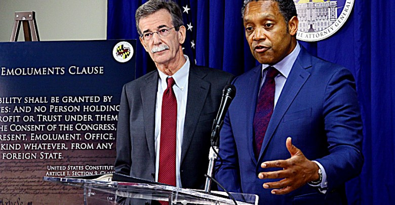 D.C. Attorney General Karl A. Racine (right) and Maryland Attorney General Brian E. Frosh hold a press conference in northwest D.C. on June 12 to announce a lawsuit alleging that President Trump's continued business entanglements violate the emoluments clause of the U.S. Constitution. (E. Watson/EDI)