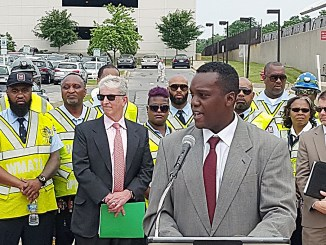 Martin Harris (at podium), deputy director of Prince George's County's Department of Public Works and Transportation, speaks during a June 16 press conference at the Twinbrook Metro station in Rockville, Maryland. (William J. Ford/The Washington Informer)