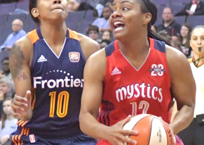 Mystics point guard Ivory Latta is defended by Sun point guard Courtney Williams during the Mystics 78-76 win at Verizon Center in Northwest on Wednesday,May 31./Photo by John E. De Freitas