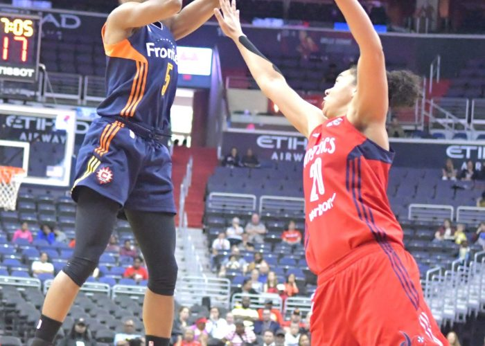 Sun point guard Jasmine Thomas shoots above Mystics forward Tianna Hawkins during the Mystics 78-76 win at Verizon Center in Northwest on Wednesday, May,31./Photo by John E. De Freitas