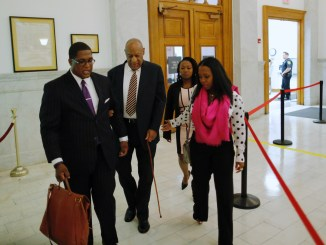 Actor Bill Cosby (second from left), accompanied by actress Keshia Knight Pulliam (right), arrives at the Montgomery County Courthouse on June 5, 2017, in Norristown, Pennsylvania, for the first day of his sexual assault trial. (Pool photo)