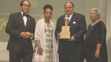 Martin Luther King III (second from right) is presented with the 2017 Lifetime Legacy Award during the National Newspaper Publishers Association's annual convention at the Gaylord National Resort and Convention Center in Oxon Hill, Maryland, on June 22. (Shevry Lassiter/The Washington Informer)