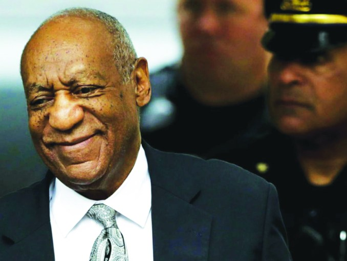 Bill Cosby smiles as he walks away from a courthouse in Pennsylvania. (Courtesy photo)