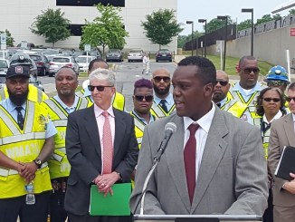 Martin Harris (at podium), deputy director of Prince George's County's Department of Public Works and Transportation, speaks during a June 15 press conference at the Twinbrook Metro station in Rockville, Maryland. (William J. Ford/The Washington Informer)