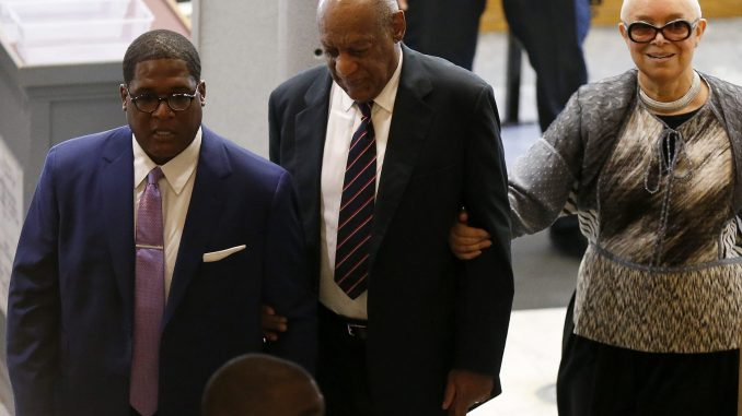 From left: Publicist Andrew Wyatt, Bill Cosby and his wife, Camille Cosby, enter the Montgomery County Courthouse in Norristown, Pennsylvania, on June 12, 2017. Cosby is on trial for sexual assault. (David Maialetti/The Philadelphia Inquirer, Pool)