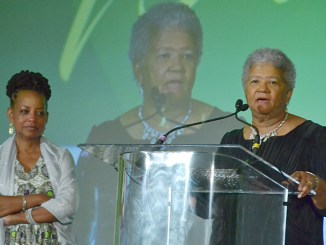 Newly-elected NNPA Chairman Dorothy Leavell gives remarks during the 2017 NNPA Legacy Awards Gala as outgoing chair, Washington Informer publisher Denise Rolark Barnes looks on. (Roy Lewis/NNPA)