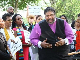Rev. Dr. William J. Barber II, president of the North Carolina State Conference of the NAACP, joins a host of national clergy July 18 on the grounds of the U.S. Capitol. Barber spoke on the failure of the current Republican-led Congress to restore the Voting Rights Act, criticized efforts to repeal the Affordable Care Act, and called upon clergy to send a message to elected officials. (E Watson/EDI)