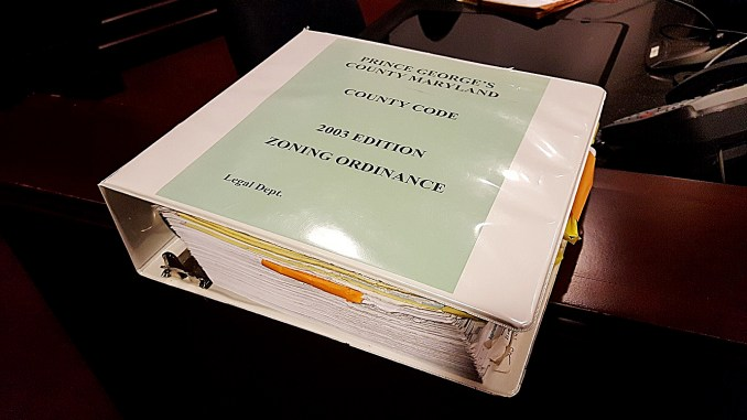 Prince George's County officials hope to shrink this nearly four-inch zoning ordinance binder with more 1,200 pages by next year. (William J. Ford/The Washington Informer)