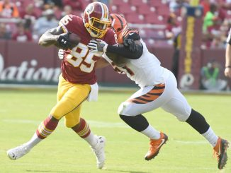 Washington Redskins tight end Vernon Jordan is tackled by Cincinnati Bengals linebacker Kevin Minter during the Redskins' 23-17 win at FedEx Field in Landover, Md., on Aug. 27. (John E. De Freitas/The Washington Informer)