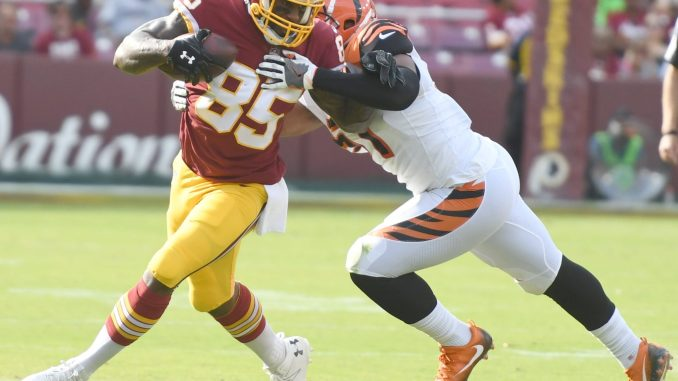 Washington Redskins tight end Vernon Jordan is tackled by Cincinnati Bengals linebacker Kevin Minter during the Redskins' 23-17 win at FedEx Field in Landover, Md., on Aug. 27. (John E. De Freitas/The Washington Informer)