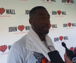 """Washington Wizards guard John Wall speaks with reporters during his John Wall Family Foundation's annual """"Back to School"""" event at the Rosedale Community Center in northwest D.C. on Aug. 18. (William J. Ford/The Washington Informer)"""